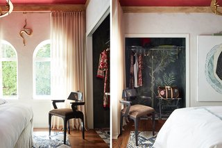 "Inspired by a recent trip to the ancient Roman villa and seaside refuge of Pompeii, Italy, this bedroom by Kari McIntosh Design serves as a tranquil retreat for special guests of the home. Soothing neutral tones—ivory walls and cream bedding—are juxtaposed with a dramatic red Venetian plaster ceiling. Tucked inside the closet is the ""Lararia,"" a lavish fresco with vibrant imagery of trees and snakes, believed by Romans to bring abundance and good fortune."