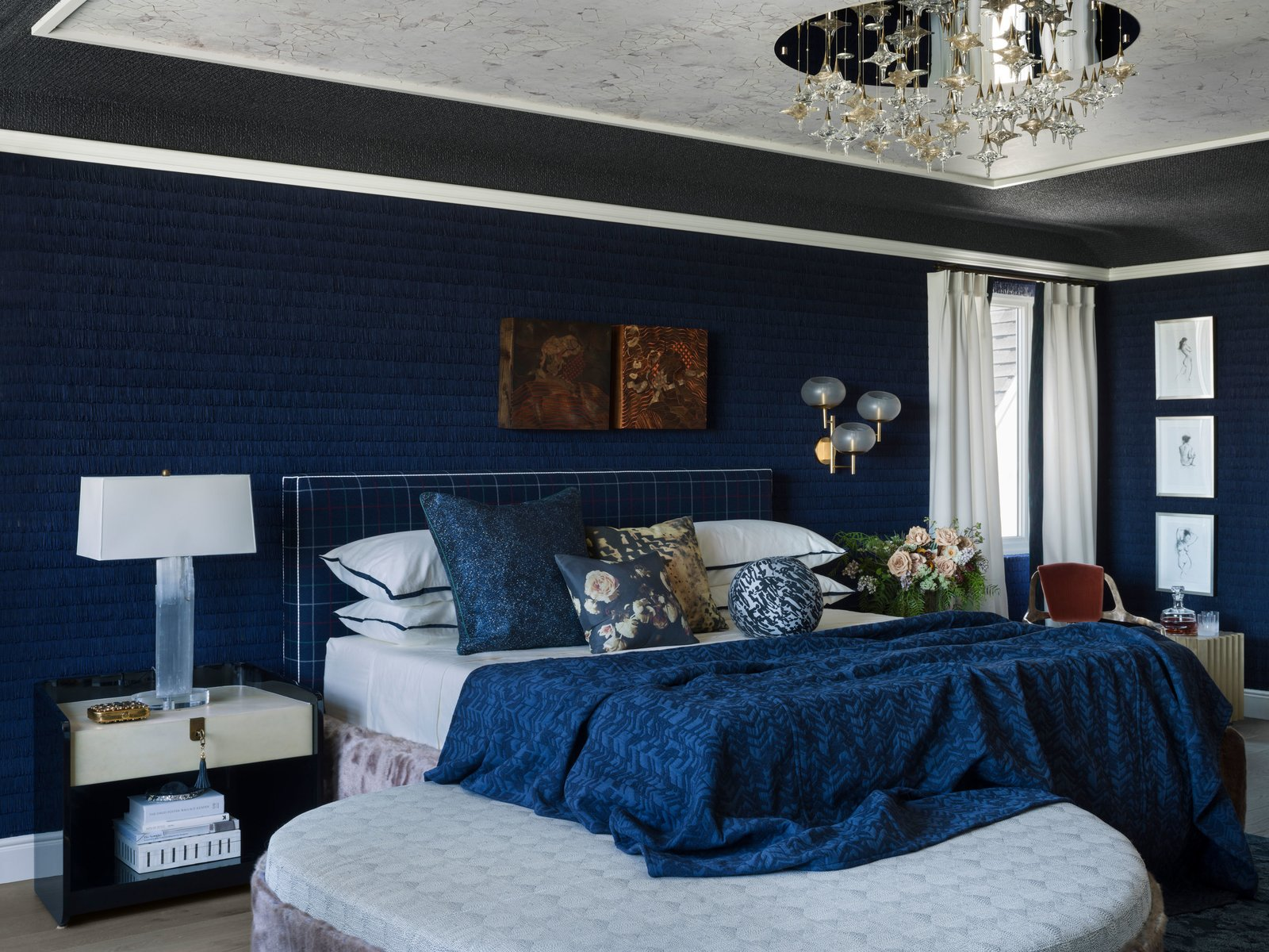 Bedroom with large center ceiling pendant chandelier light with mirror base and star shaped bulbs