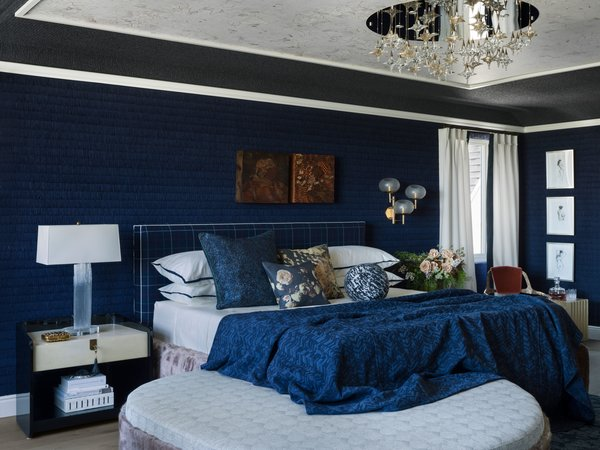 "Jeff Schlarb calls the master bedroom ""Ten Thousand Dreams"" for its ability to ""allow dreams to flourish."" The spectacular chandelier-style pendant with romantic, star-shaped lights was chosen to do just that."
