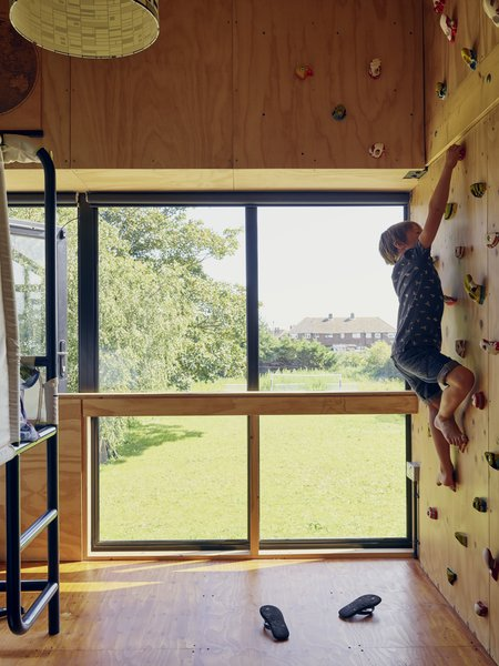 In the booming British beach town of Margate, longtime locals Natasha Hart and Oliver Whitmarsh teamed up with newcomer architects RL-a to salvage a 19th-century workers' lodging. Their son Stan's bedroom includes a vintage Habitat Skipper bed by Loïck Peyron and a climbing wall designed by Natasha. The plywood finishes are kid-friendly and also affordable.