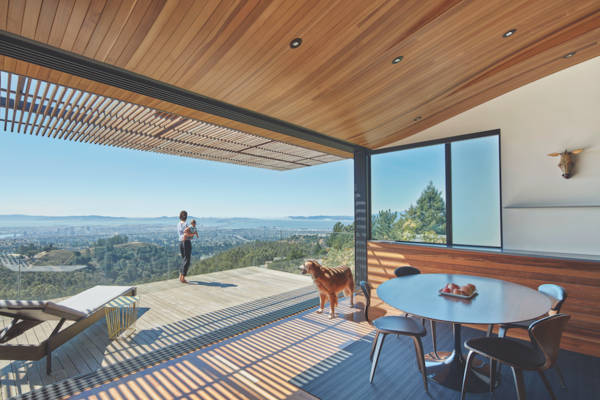 "To prioritize the Skyline House's stunning San Francisco Bay views, architect Ivan Terry crafted a Western Red Cedar ""wood tube"" that allows for front to back views of the bay."
