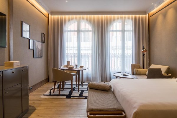 Looking for master bedroom lighting ideas for a tray ceiling? Draw some inspiration from this elegant hotel room, where lighting is strategically placed along the sides of the recessed ceiling, providing subtle downlighting for the room.