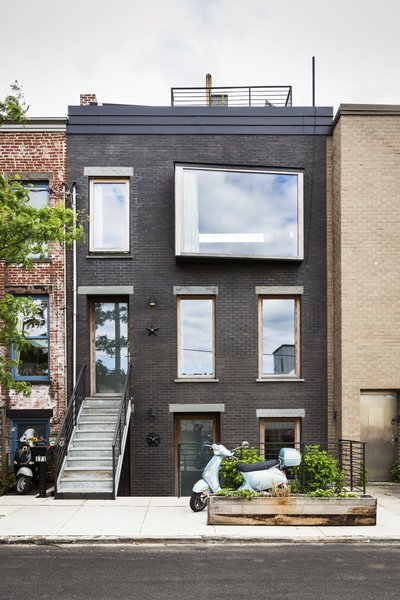 Architect Allison Reeves was renovating a townhome in Red Hook when she discovered that the existing redbrick facade was falling apart. With contractor John Fasano, she put in a new exterior of dark bricks, punctuated by a slanted pane of glass by Bieber Windows. A new roof supports a deck as well as the home's mechanicals, which the residents opted to move out of harm's way after Hurricane Sandy flooded other homes in the area.