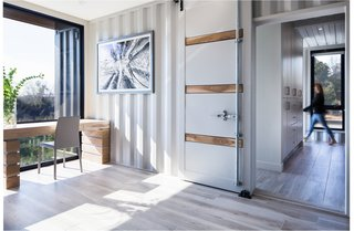 The bedrooms and bathrooms are housed within the 40-by-8-foot boxes, separated by a skylit corridor.
