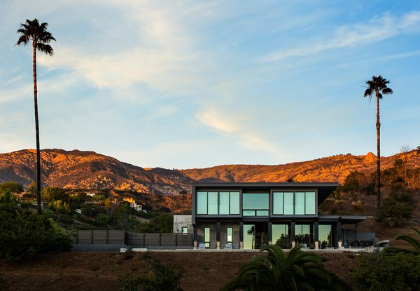 For Bret and Dani Stone's house in Santa Barbara, California, Barber Builders erected a concrete-and-steel ground level capable of supporting a second story made mostly of shipping containers. While the project as a whole took 19 months, the containers were craned into place in a single day in 2016.