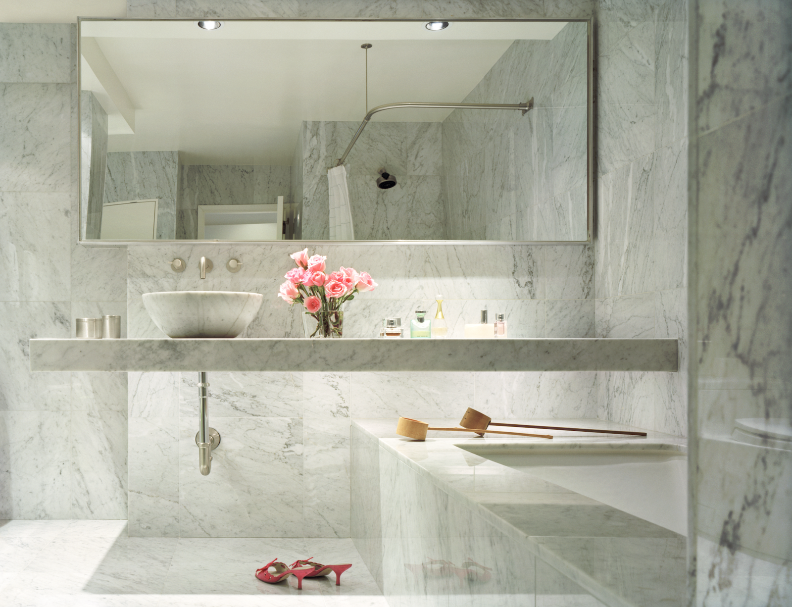 Bath Room, Vessel Sink, Recessed Lighting, Marble Floor, Undermount Tub, Marble Wall, and Marble Counter Hariri and her husband have separate bathrooms, each with their preferred. He preferred a shower, but Hariri wanted a tub.  Photo 8 of 9 in Acclaimed Architect Gisue Hariri Invites Us Into Her Intimate Manhattan Loft