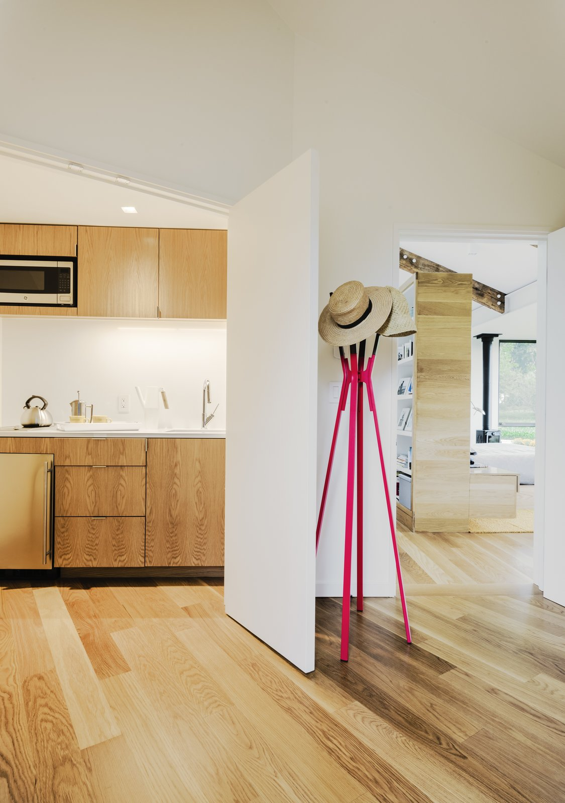 A coat rack by Blu Dot stands at the entrance to the new master suite.  Photo 7 of 19 in Each Generation Builds on the Last at This Rural Retreat in Western Pennsylvania