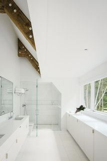 Caesarstone counters run along the bathroom walls.