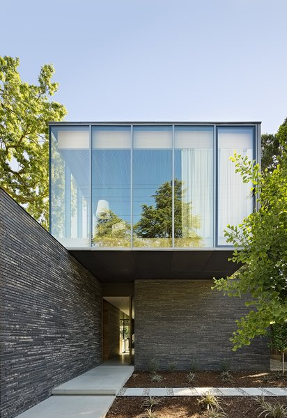The second floor, which houses Mark's office, has aluminum-framed windows on three sides and opens to a roof deck.