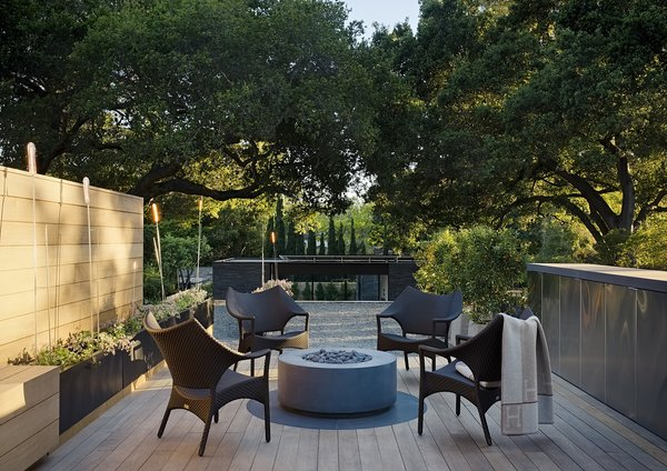 The roof deck is outfitted with Janus et Cie Amari Low Back lounge chairs.