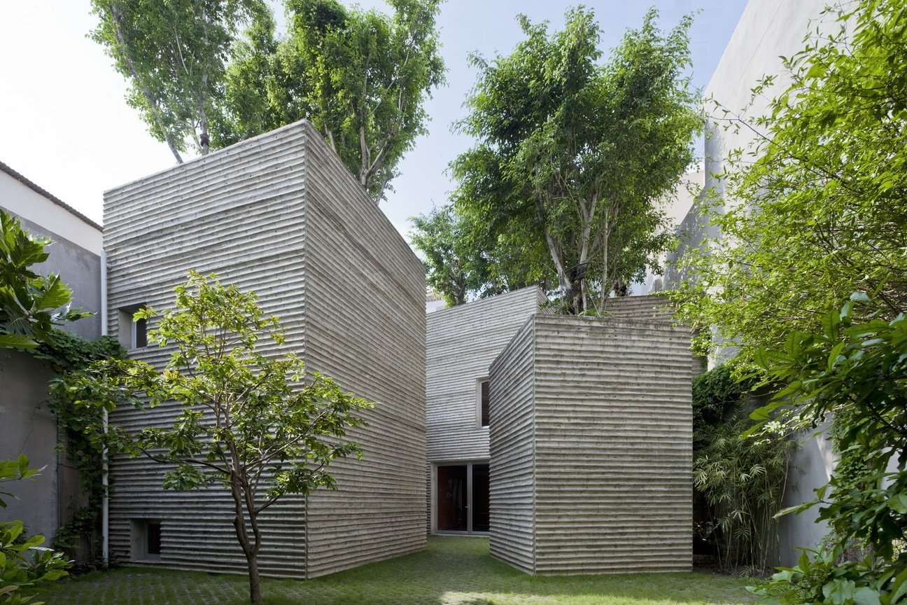 Outdoor, Trees, Grass, and Concrete Patio, Porch, Deck This project sparks a conversation about the future of the relationship between urban development and the preservation of natural areas.  Best Photos from A Concrete Home in Vietnam Is Topped With Trees