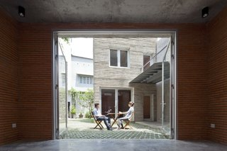 The open courtyard brings warmth and light into the home.