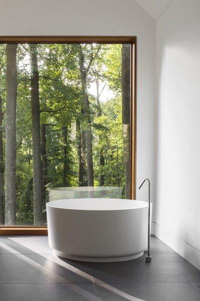 The master bathroom features an Agape tub with a Watermark filler.