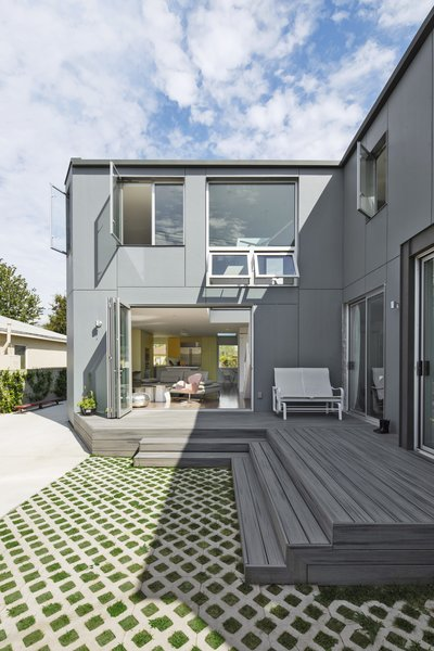 "For his own home in Mar Vista, architectural designer Mohamed Sharif retained the front portion of a 1940s bungalow and added an L-shaped, two-story volume at the rear that includes a wing for his mother-in-law. ""Adapting and reusing and being sensitive to the neighborhood context was important,"" he says. The structure is sheathed in fiber cement HardiePanels. The decking is by Trex."