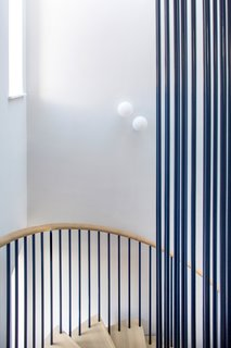 Produk also built the steel-and-oak staircase, which homeowner Charlie Barda helped design.
