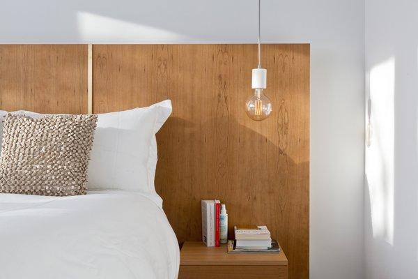 Jon Needham of Rochlin Bespoke created the cherry lacquer headboard in the master bedroom.