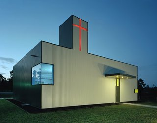 Marlon Blackwell Architects converted a generic shop building in Springdale, Arkansas, into the St. Nicholas Eastern Orthodox Church. Grounding the structure to its roots, parts of the existing building are left exposed, while the exterior skin of box rib metal panel is a nod to local, industrial forms.