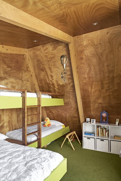 Beneath the pitched roof, there's a bedroom with custom bunks for visiting grandchildren.