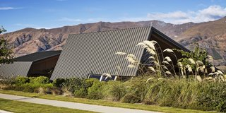 The family has been coming to Wanaka for decades. They bought the hanging metal sculpture in a local shop some 30 years ago. On the street-facing side (bottom, right), the roof folds down almost to the ground to protect the owners' privacy.