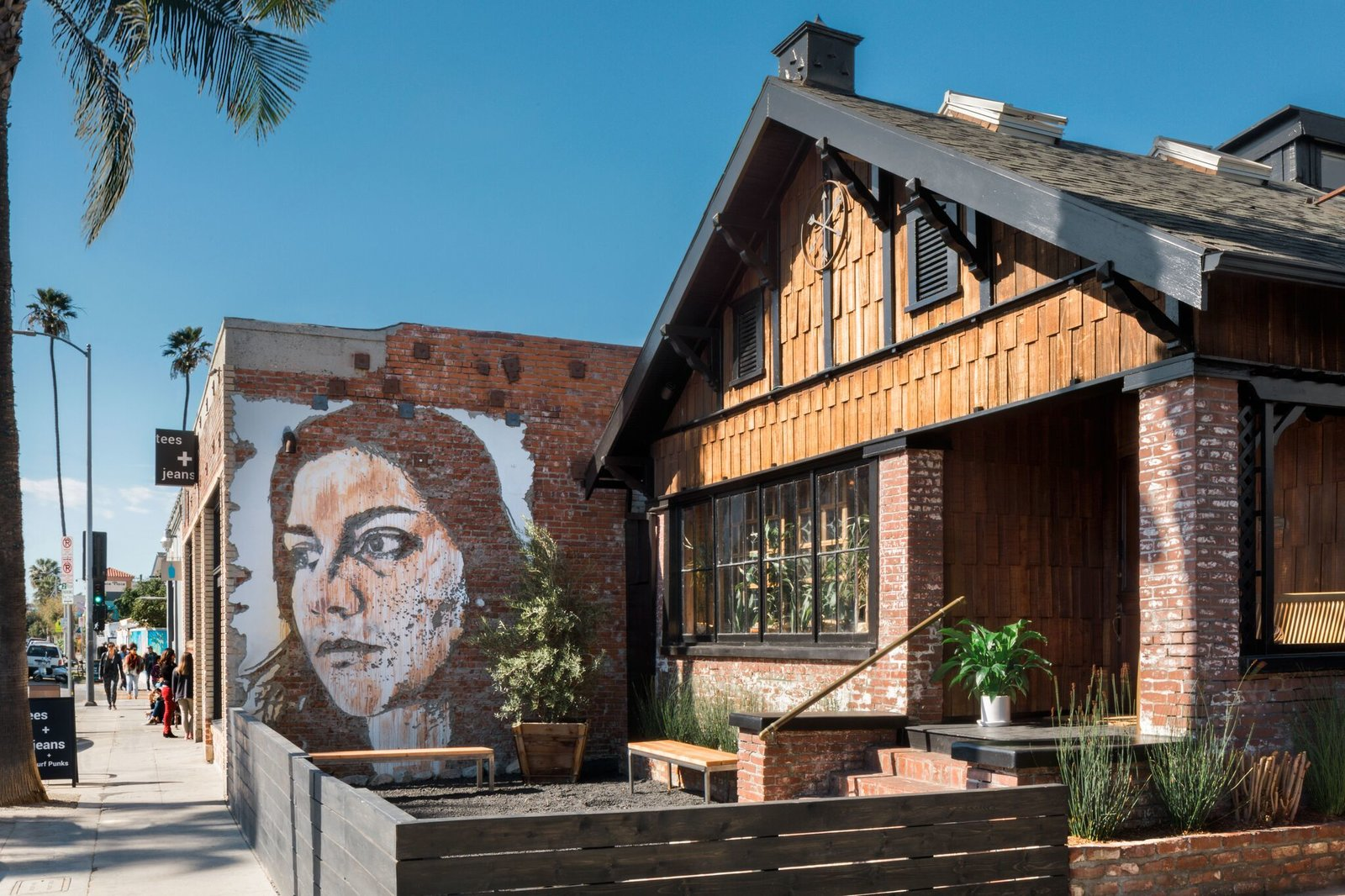 "Exterior, Wood Siding Material, House Building Type, Tile Roof Material, Brick Siding Material, and Gable RoofLine ""Upon arrival, you enter straight off Abbott Kinney into a calm room where members check in,  Photo 1 of 8 in A 1940s Beach Home Is Restored Into a Gorgeous Clubhouse in L.A."