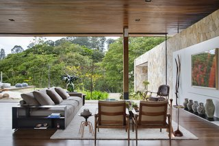Moveable glass walls allow the home to open completely to the garden.