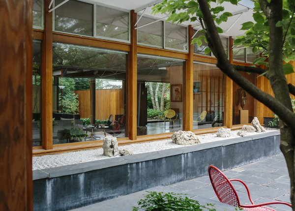 The house centers on a courtyard, complete with slate pavers, a dogwood tree, and rock gardens.