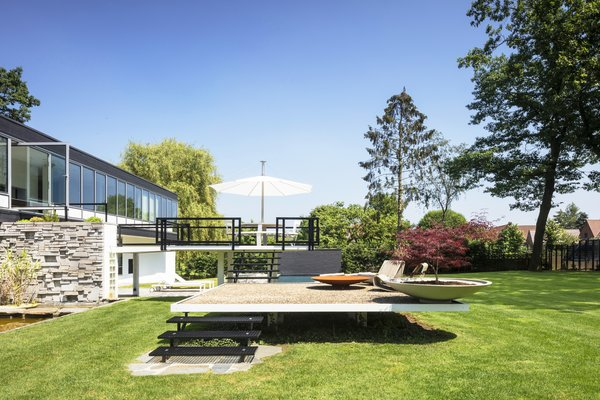 Much of the concrete and metalwork for the multilevel, L-shaped terrace had to be  redone. The Pantagruel picnic table is by Dirk Wynants for Extremis; the 1966 Adjustable Chaises are by Richard Schultz for Knoll.