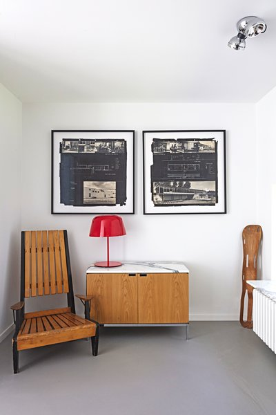An Eames leg splint, a Florence Knoll credenza, and a chair by Engels furnish the office.