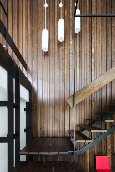 With an assist from preservation expert Lotte Van Hemelrijck, architect Thomas van Looij led the restoration, which included refinishing  or replacing a wall of sun-damaged Wenge wood panels.