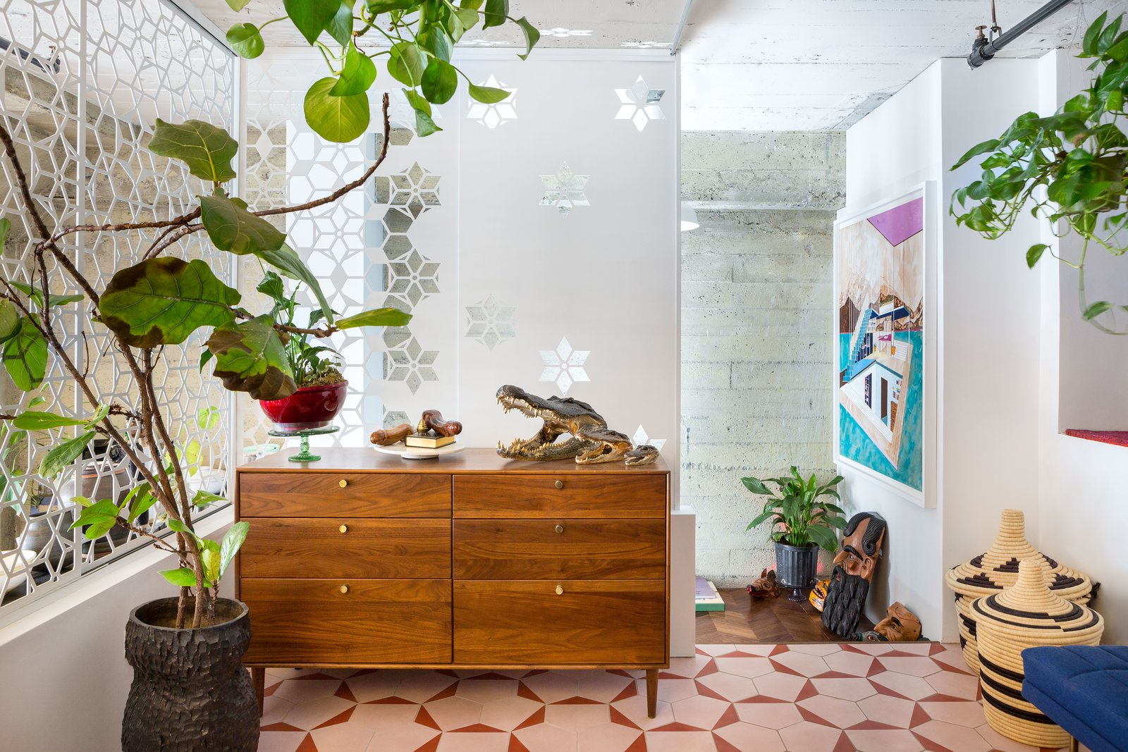 Storage Morrison's dressing room features pink cement tiles from Bay Area company Cle Tiles. The screens were actually designed to match the tiles.  Best Storage Photos from Budget Breakdown: A Bay Area Warehouse Becomes a Live/Work Space For $124K