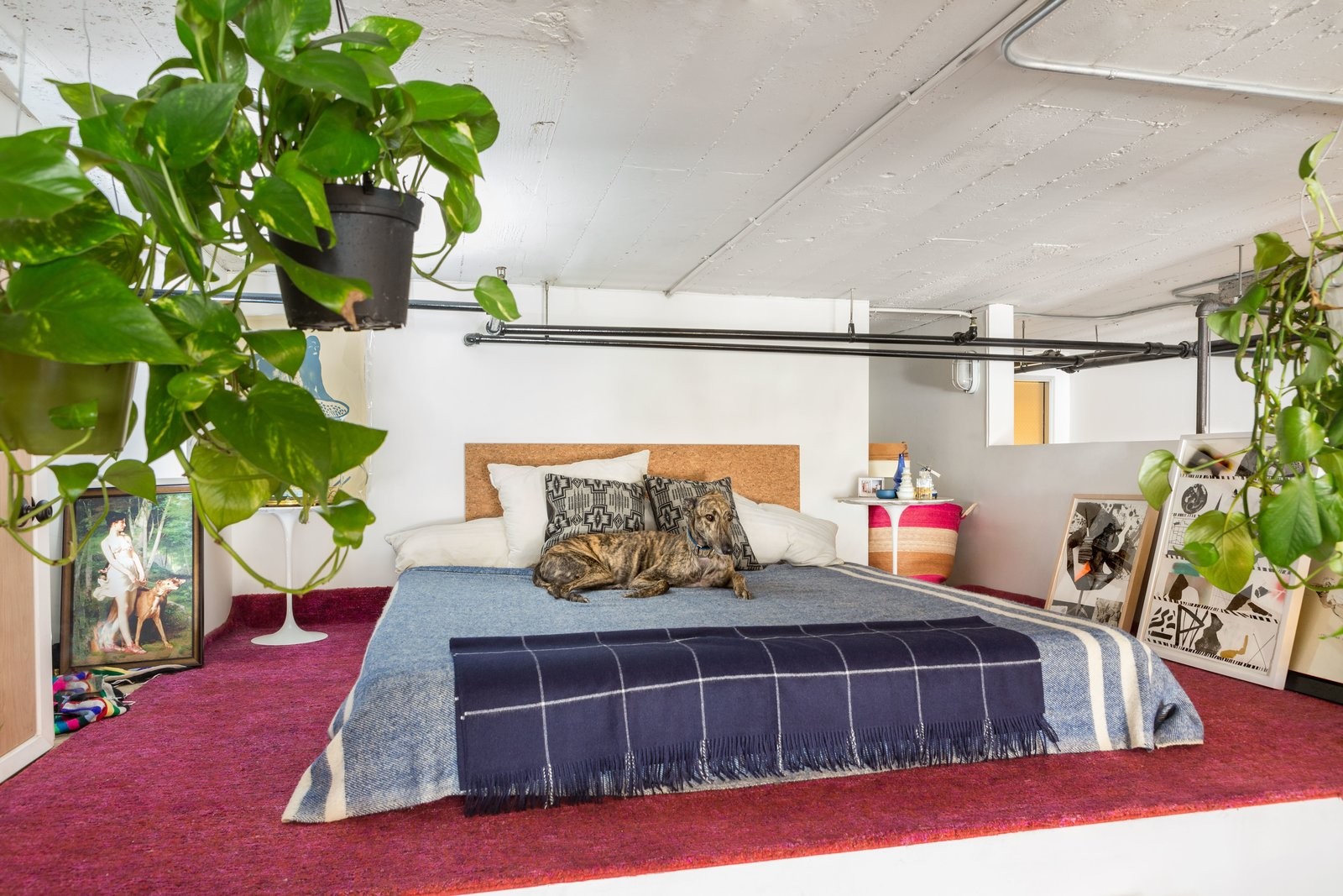 Bedroom, Rug Floor, Bed, Wall Lighting, and Night Stands The bed occupies a cozy alcove.  Best Photos from Budget Breakdown: A Bay Area Warehouse Becomes a Live/Work Space For $124K