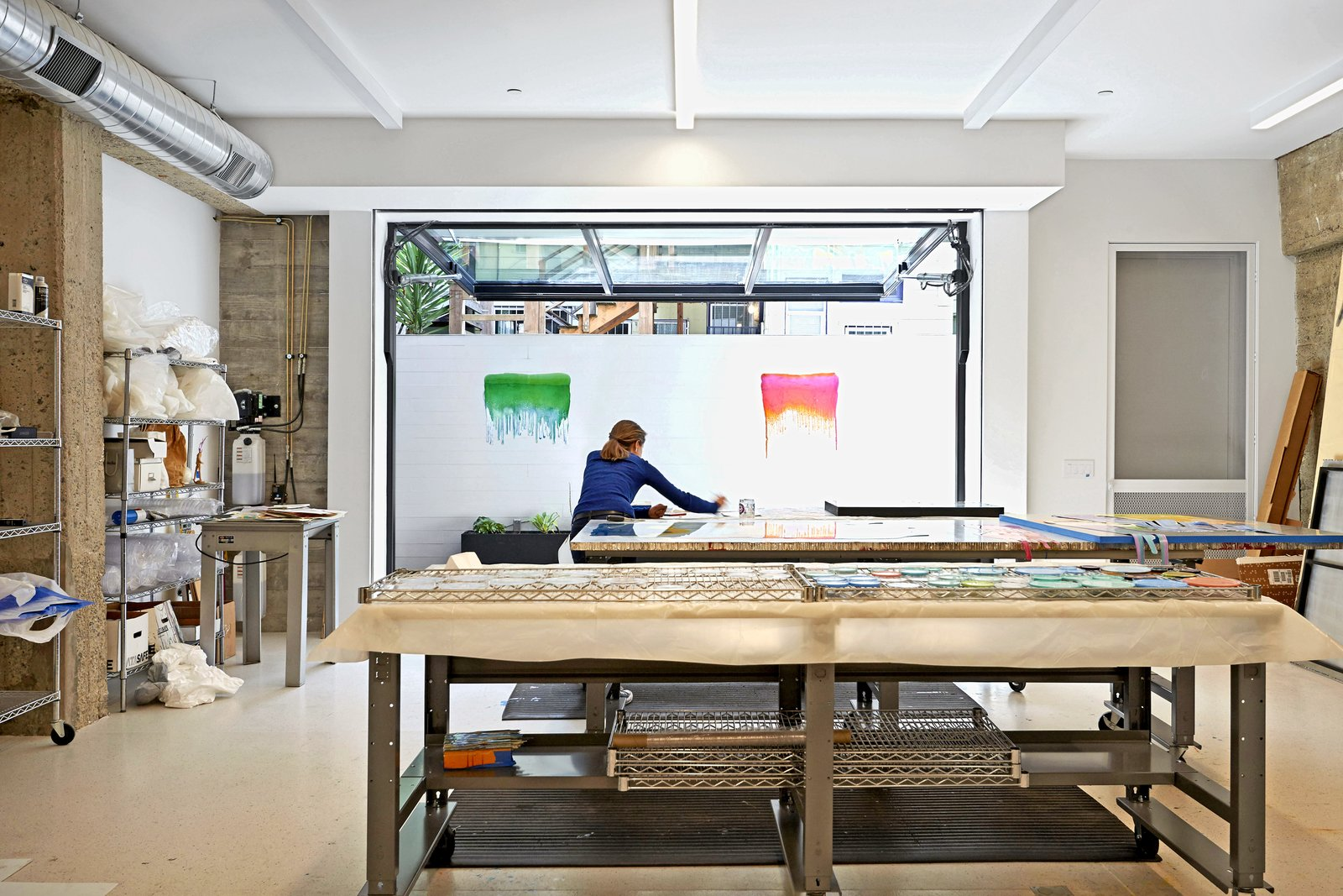 Office Klari at work in her studio.  Best Photos from Before & After: A Car Shop in San Francisco Is Reborn as an Artist's Loft, Gallery, and Studio