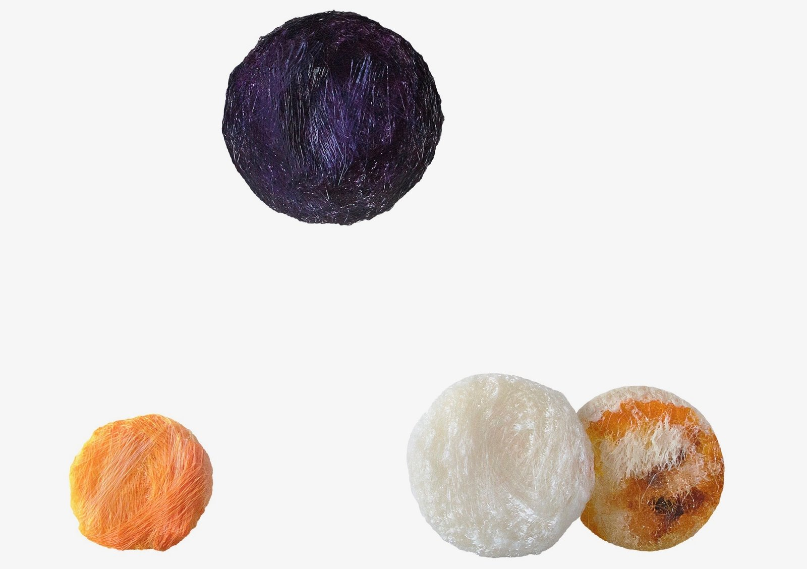 """Crafting Plastics! Studio pioneered an eco-friendly """"bioplastic"""" to create a series of round,  hand-crafted light fixtures called Collection 4. The shaggy strands of material were dyed using plant pigments.  Photo 18 of 25 in Meet the Dwell 24: Two Dozen Up-and-Coming Designers to Watch in 2018"""