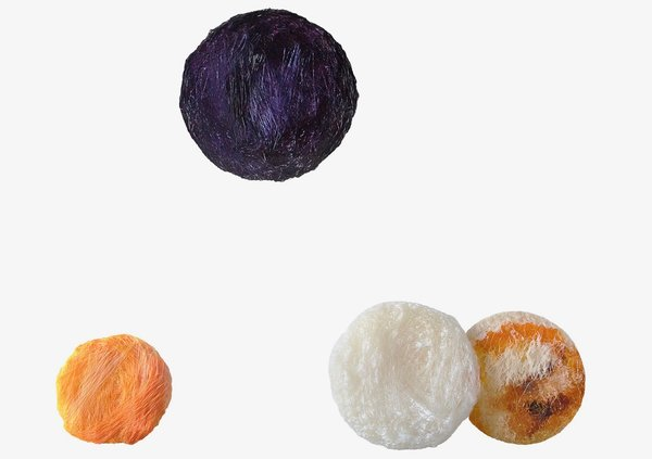 """Crafting Plastics! Studio pioneered an eco-friendly """"bioplastic"""" to create a series of round,  hand-crafted light fixtures called Collection 4. The shaggy strands of material were dyed using plant pigments."""