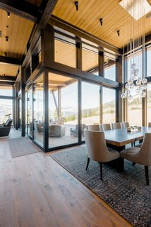 "A magnificent corner sliding door unit opens up to expand the home to an outdoor deck.  ""When you walk in and look at the mountains, the beauty is overwhelming,"" adds Pam."