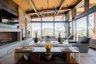 "For outdoor enthusiasts Bob and Pam Norton, the town of Big Sky, Montana, was a natural choice for the location of their second home. Having purchased a remote lot with views of Lone Peak, Pioneer Mountain, and Cedar Mountain, they envisioned a private, year-round retreat that integrated with the terrain. ""We wanted to live in the view,"" says Pam. ""We wanted the outdoors to come in."""