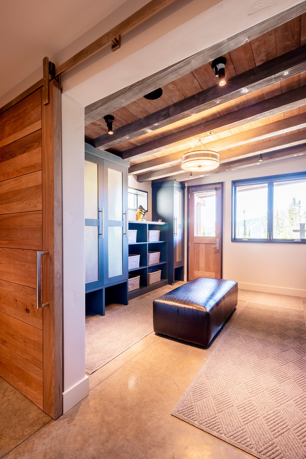 Storage Room Ski-in, ski-out access—and a dedicated ski room—give the homeowners direct access to the slopes.  Photo 8 of 12 in A Mountain Retreat in Montana Allows One Couple to Live in the View