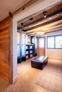 Ski-in, ski-out access—and a dedicated ski room—give the homeowners direct access to the slopes.