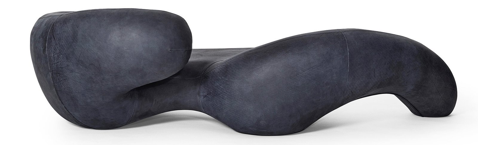 Living Room and Chair Rich Mnisi's sinuous chaise lounge is wrapped in  navy-colored leather.  Photo 17 of 25 in Meet the Dwell 24: Two Dozen Up-and-Coming Designers to Watch in 2018