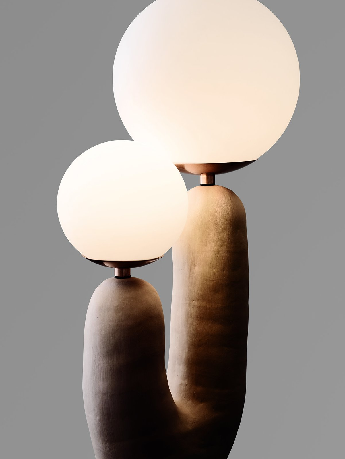 Living Room and Lamps Eny Lee Parker's hand-formed ceramic Oo lamp has the sculptural quality that distinguishes her furniture and lighting.  Photo 9 of 25 in Meet the Dwell 24: Two Dozen Up-and-Coming Designers to Watch in 2018