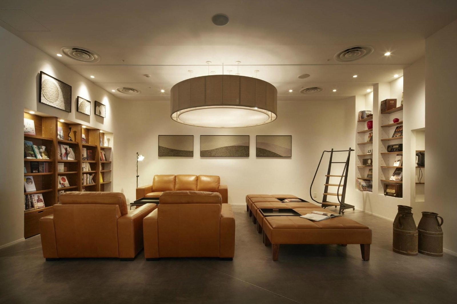 Living Room, Shelves, Floor Lighting, Sofa, Recessed Lighting, Pendant Lighting, Bench, Concrete Floor, and Lamps Agora Fukuoka Hilltop Hotel & Spa in Fukuoka, Japan  Photo 3 of 11 in 10 Alluring Places to Stay in Japan Under $300 a Night from Agora Fukuoka Hilltop Hotel & Spa
