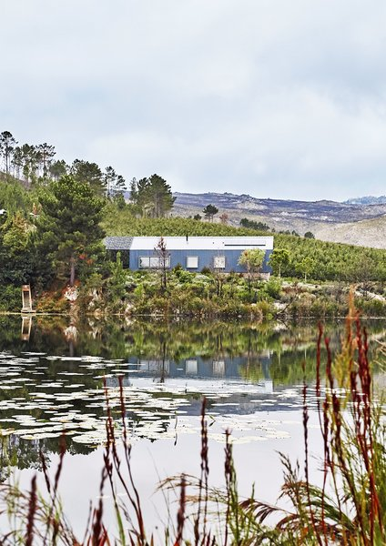The home is perched beside a two-acre reservoir, a favorite spot for bird watching.