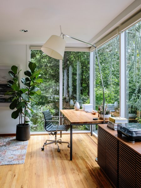 Office, Study Room Type, Chair, Medium Hardwood Floor, Desk, Lamps, and Storage The office area features a Tolomeo Mega floor lamp by Michele De Lucchi and Giancarlo Fassina for Artemide.  Best Photos from This House in Oregon Has a Long, Strange History of Being Called a Frank Lloyd Wright