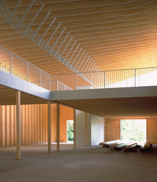 For the Minneapolis Rowing Club Boathouse, VJAA used a rhythmic series of roof trusses made out of glue-laminated beams, steel posts, and steel cables. As the angled trusses come together and support the curving, plywood roof structure, they reflect the power and grace of a rower's oar stroke.