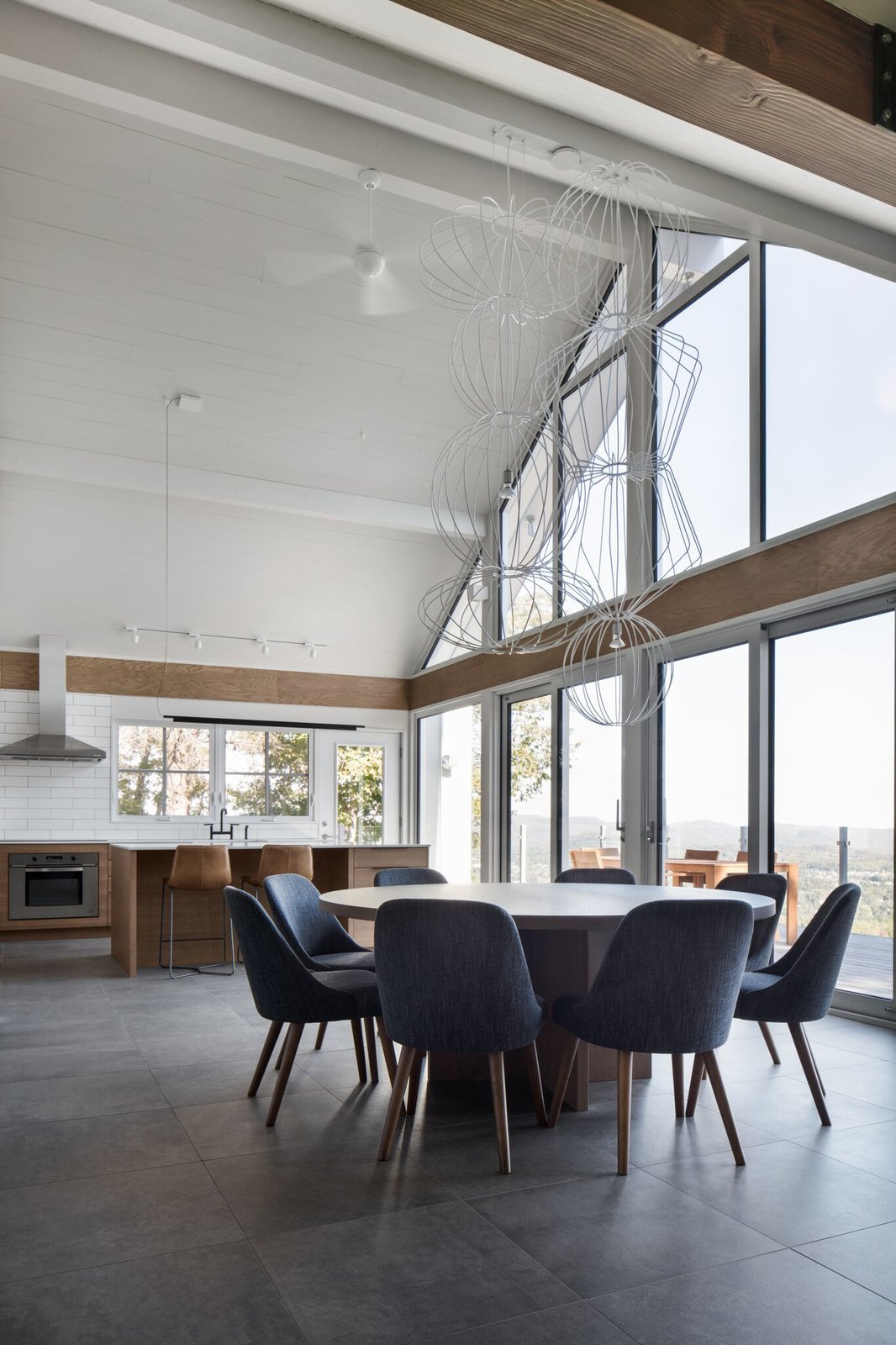 Dining Room, Chair, Table, and Pendant Lighting The dining room suspension light is a custom design by Robert Franco. The dining chairs are by West Elm.  Photo 8 of 13 in A 1960s Canadian Ski House Is Rebuilt Into a Gorgeous Abode