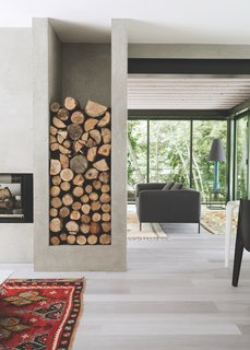 Built-in storage for firewood allows the homeowners to stack logs by the fireplace.