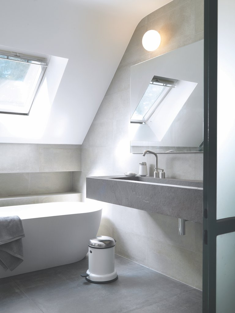 Bath, Wall, Wall Mount, and Freestanding A skylight allows natural light to flow over the freestanding tub. The taps, soap dispenser, and pedal bin are by Vipp.  Best Bath Freestanding Wall Mount Photos from A Stone Retreat in France Gets a Sleek Glass Addition