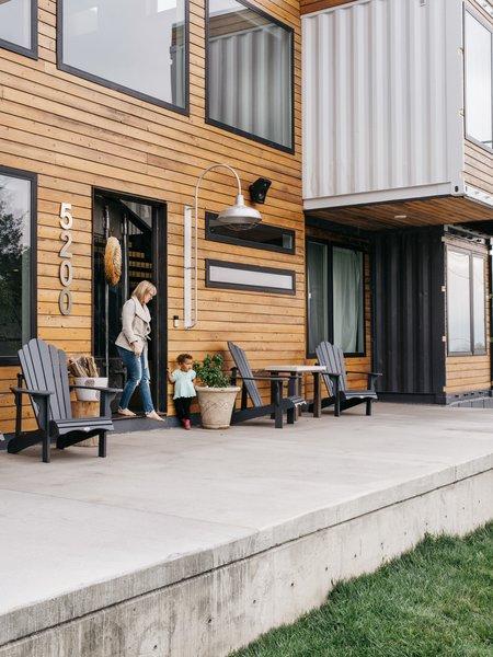 A concrete patio wraps around the house.