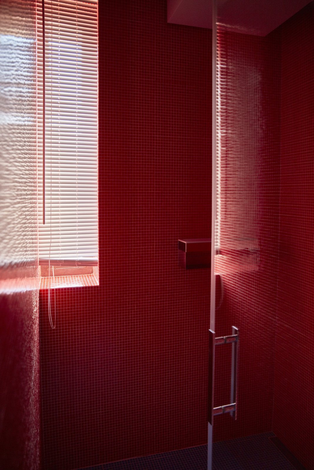 Bath, Glass Tile, and Corner The mosaic wall tiles are by Trend.  Best Bath Glass Tile Corner Photos from An Architect Unites Three Brutalist Villas He Designed on Sardinia in the 1970s