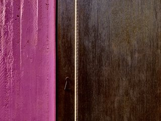 All across the property, blocks of jewel-toned color meet raw materials, like a hot pink concrete wall next to a Cor-Ten steel door with a rebar handle.